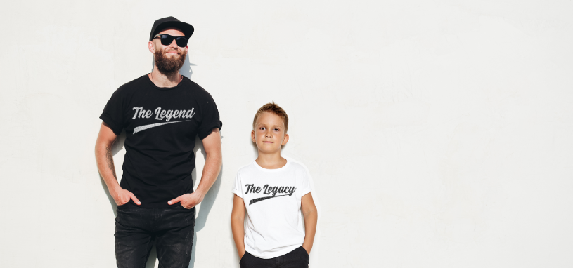 Father and son wearing t-shirts against a white wall