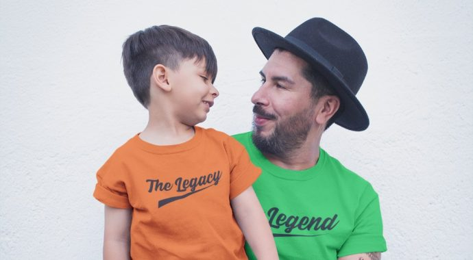 Father and son wearing legends t-shirts